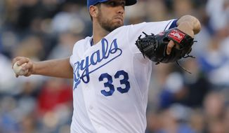 Kansas City Royals starting pitcher James Shields delivers to a Colorado Rockies batter during the first inning of a baseball game at Kauffman Stadium in Kansas City, Mo., Tuesday, May 13, 2014. (AP Photo/Orlin Wagner)