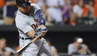 Detroit Tigers' Miguel Cabrera swings on a three-run home run against the Baltimore Orioles in the ninth inning of a baseball game Tuesday, May 13, 2014, in Baltimore. The Tigers won 4-1. (AP Photo/Gail Burton)