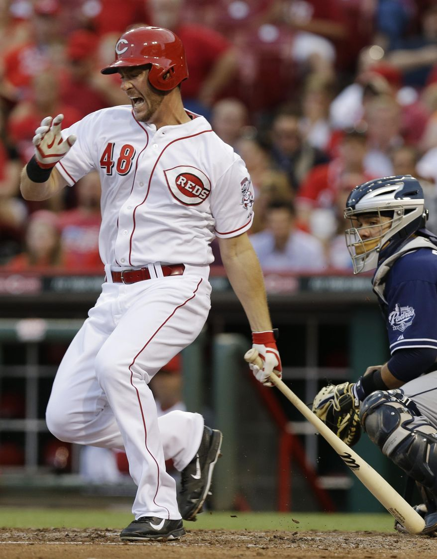 Cincinnati Reds' Ryan Ludwick hits a foul ball off his foot in the fourth inning of a baseball game against the San Diego Padres, Tuesday, May 13, 2014, in Cincinnati. Rene Rivera catches at right. Ludwick struck out on the at-bat. (AP Photo)