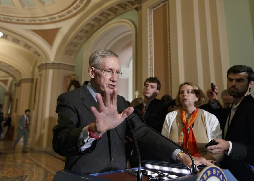 **FILE** Senate Majority Leader Harry Reid, Nevada Democrat, speaks to reporters after a Democratic caucus lunch on Capitol Hill in Washington on May 13, 2014. (Associated Press)