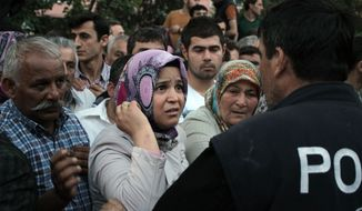 Relatives try to get information outside a local hospital after an explosion and fire at a coal mine in Soma, in western Turkey, Tuesday, May 13, 2014.  An explosion and fire at a coal mine in western Turkey killed at least one miner Tuesday and left up to 300 workers trapped underground, a Turkish official said. Twenty people were rescued from the mine in the town of Soma in Manisa province but one later died in the hospital, Soma administrator Mehmet Bahattin Atci told reporters. The town is 250 kilometers (155 miles) south of Istanbul. (AP Photo/Depo Photos)