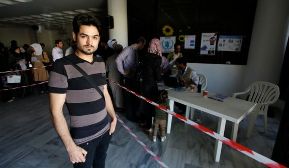Wissam, 26, arrived in Lebanon from Aleppo with his wife and son. He doesn't receive the aid of $30, but his wife and son each receive $30 as part of the e-card program. Photo by Omar Alkalouti