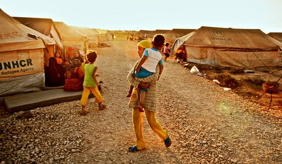 The Zaatari refugee camp in Mafraq, near the border of Syria. The tents were suppose to be temporary but have not been moved since the camp was built in July of 2012. Zaatari, is estimated to hold 120,000 refugees. Jordan currently hosts 202,700 Syrian displaced. 22,000 of which are living in the camp with hundreds more arriving daily as a result of the civil war raging  in their country. The youth in the camp have no daycare facilities or schools to attend.  Mafraq, Jordan August 11, 2012. Photo by Omar Alkalouti