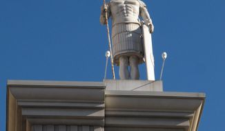 FILE - This file photo taken Dec. 27, 2013, shows a statue of a Roman centurion atop the Caesars Atlantic City casino in Atlantic City, N.J. Figures released on May 14, 2014 showed that Internet gambling in New Jersey saw its first slight decline in April 2014, to $11.4 million. (AP Photo/Wayne Parry, File)