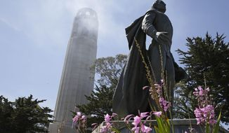 A statue of Christopher Columbus stands beneath Coit Tower Wednesday, May 14, 2014, in San Francisco. San Francisco's landmark Coit Tower reopened to the public Wednesday after a six-month, $1.7 million upgrade that included restoration of its famed murals. (AP Photo)