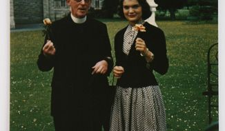 "In this image made available by Sheppard's Irish Auction House made available on Wednesday May 14, 2014 shows Rev. Joseph Leonard with Jacqueline Kennedy at All Hallows College in Dublin Ireland in 1950.  Letters written by Jacqueline Kennedy to an Irish priest have revealed new details about her closely guarded private thoughts. The letters are set to be auctioned next month and could fetch up to $1.6 million. The more than 30 letters were written to the Rev. Joseph Leonard. They were recently discovered in a drawer at All Hallows College. In one, she questioned her faith after the assassination of President John F. Kennedy. ""I am so bitter against God,"" she wrote a few months after the assassination of her husband. (AP Photo/Sheppard's Irish Auction House) NO ARCHIVE ONE TIME USE ONLY  ONLY TO BE USE IN CONNECTION WITH STORY RELATED TO THE AUCTION"