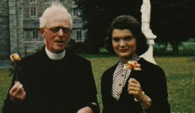 """In this image made available by Sheppard's Irish Auction House made available on Wednesday May 14, 2014 shows Rev. Joseph Leonard with Jacqueline Kennedy at All Hallows College in Dublin Ireland in 1950.  Letters written by Jacqueline Kennedy to an Irish priest have revealed new details about her closely guarded private thoughts. The letters are set to be auctioned next month and could fetch up to $1.6 million. The more than 30 letters were written to the Rev. Joseph Leonard. They were recently discovered in a drawer at All Hallows College. In one, she questioned her faith after the assassination of President John F. Kennedy. """"I am so bitter against God,"""" she wrote a few months after the assassination of her husband. (AP Photo/Sheppard's Irish Auction House) NO ARCHIVE ONE TIME USE ONLY  ONLY TO BE USE IN CONNECTION WITH STORY RELATED TO THE AUCTION"""