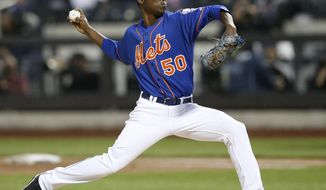 New York Mets starting pitcher Rafael Montero (50) delivers in the second inning against the New York Yankees in a baseball game in New York, Wednesday, May 14, 2014. (AP Photo/)