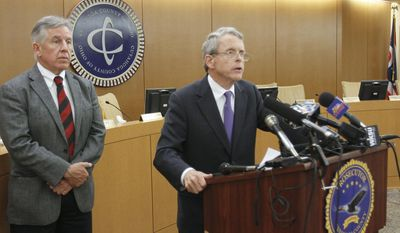 Ohio Attorney General Mike DeWine, right, and joined by Cuyahoga County Prosecutor Timothy J. McGinty, announce corruption indictments against the Youngstown Mayor John McNally, Mahoning County Auditor Mike Sciortino  and attorney Martin Yavorcik Wednesday, May 14, 2014, in Cleveland. (AP Photo/Robert K. Yosay, The Vindicator)