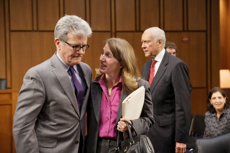 "Sylvia Mathews Burwell, President Obama's nominee to become Health and Human Services Secretary, center, is greeted by Sen. Tom Coburn, Oklahoma Republican. Sen. Coburn described her as ""competent."" (Associated Press)"
