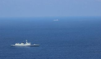 On May 5, the Navy's 7th Fleet command ship USS Blue Ridge encountered two Chinese warships near the disputed Scarborough Shoal. (U.S. Navy)