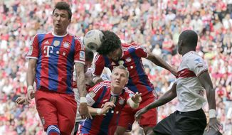 Bayern's Mario Mandzukic of Croatia, from left, teammate Dante and Bastian Schweinsteiger challenge for the ball during the German first division Bundesliga soccer match between FC Bayern Munich and VfB Stuttgart, in Munich, southern Germany, Saturday, May 10, 2014. (AP Photo/Matthias Schrader)