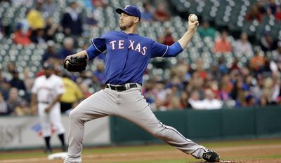 Texas Rangers' Matt Harrison delivers a pitch against the Houston Astros in the first inning of a baseball game Tuesday, May 13, 2014, in Houston. (AP Photo)