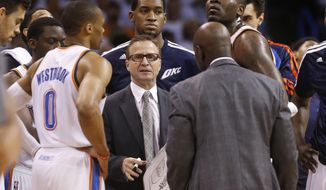 Oklahoma City Thunder coach Scott Brooks talks to his team in the first quarter of Game 5 of the Western Conference semifinal NBA basketball playoff series against the Los Angeles Clippers, in Oklahoma City on Tuesday, May 13, 2014. (AP Photo)