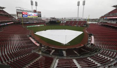 Rain falls on Great American Ballpark prior to the start of a baseball game between the Cincinnati Reds and the San Diego Padres, Wednesday, May 14, 2014, in Cincinnati. The start of the game is being delayed by rain. (AP Photo)