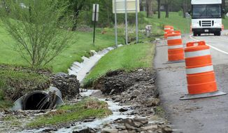 Water flows along the side of the Route 14A after a Penn Yan, N.Y., on Wednesday, May 14, 2014.  Severe storms that dumped up to five inches of rain have forced evacuations and closed roads in the Finger Lakes region. Authorities tell local media that flash flooding forced some homes to be evacuated early Wednesday morning in the Yates County village of Penn Yan, on the northern end of Keuka Lake 45 miles southeast of Rochester. The National Weather Service says thunderstorms that began hitting the region late Tuesday night dumped about five inches of rain in four hours.  (AP Photo/The Times, Spencer Tulis )