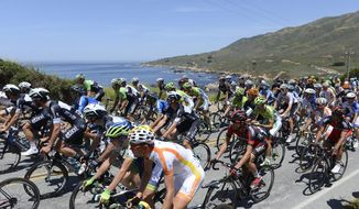 The Peleton pass Sobranes Point in northern Big Sur, Calif.,  during the 2014 Amgen Tour of California on Wednesday May 14, 2014. The fourth stage took riders from downtown Monterey along Highway One to Cambria in San Luis Obispo.  (AP Photo/Monterey Herald, David Royal)