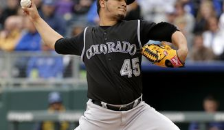 Colorado Rockies starting pitcher Jhoulys Chacin throws during the first inning of a baseball game against the Kansas City Royals Wednesday, May 14, 2014 in Kansas City, Mo. (AP Photo/Charlie Riedel)