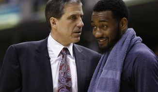Washington Wizards head coach Randy Wittman, left,  talks with John Wall during the second half of game 5 of the Eastern Conference semifinal NBA basketball playoff series against the Indiana Pacers Tuesday, May 13, 2014, in Indianapolis. Washington defeated Indiana 102-79. (AP Photo/Darron Cummings)