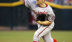 Washington Nationals pitcher Stephen Strasburg throws against the Arizona Diamondbacks during the second inning of a baseball game on Tuesday, May 13, 2014, in Phoenix. (AP Photo/Matt York)