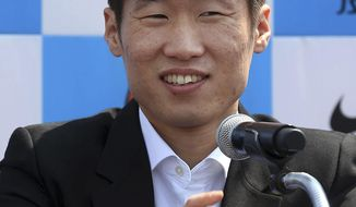 Park Ji-sung, a former Manchester United regular and one of the stars of South Korea's run to the 2002 World Cup soccer semifinals, speaks during a press conference in Suwon, South Korea, Wednesday, May 14, 2014. Park announced his retirement from top-flight football. (AP Photo/Yonhap, Kim Soo-jin) KOREA OUT