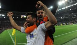Sevilla's Coke, left, celebrates with teammate Javi Varas after winning the Europa League soccer final between Sevilla and Benfica, at the Turin Juventus stadium in Turin, Italy, Wednesday, May 14, 2014.  Sevilla beat Benfica 4-2 on penalties to win the Europa League final. (AP Photo/Massimo Pinca)