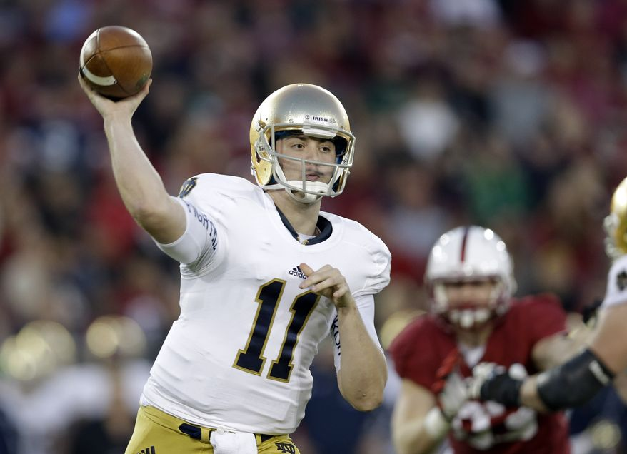 Notre Dame quarterback Tommy Rees throws against Stanford during the first half of an NCAA college football game on Saturday, Nov. 30, 2013, in Stanford, Calif. (AP Photo/Marcio Jose Sanchez)