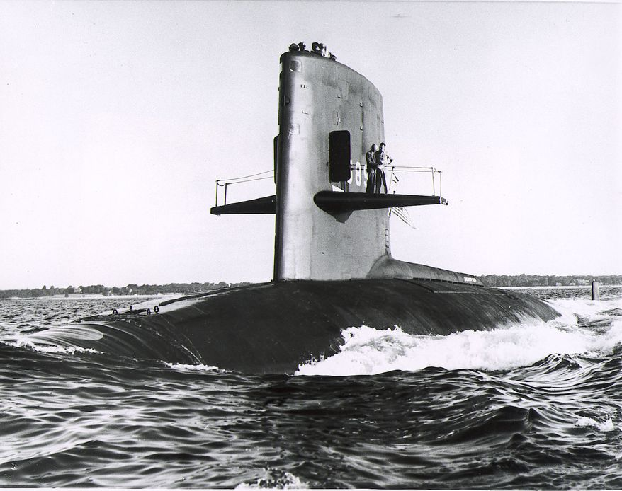 """The nuclear submarine USS Scorpion is seen in the Atlantic Ocean in 1968 - The nuclear attak submarine Scorpion which was reported overdue at sea by the Pentagon May 27, 1968. A defense department statement said the sub had been scheduled to return to Norfolk, Va., at 1 P.M. May 27 at the end of a routine training operation. The Scorpion was last heard from May 21, 1968. This June 27, 1960, Handout picture shows the """"USS Scorpion"""" nuclear-powered attak submarine (SSN-589) at New London, Ct., USA during builders trials. Vice Admiral Hyman G. Rickover is standing on her sailplanes with another officer. (AP-Photo/ag/u.s. Navy-HO)    June 08, 2000"""