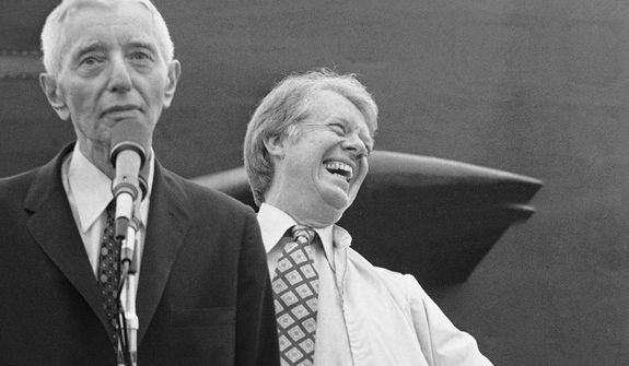 President Jimmy Carter gives a big laugh as Admiral Hyman Rickover talks about their nuclear submarine cruise, May 27, 1977 off the coast of Port Canaveral, Fla. They spent about nine hours aboard the nuclear sub U.S.S. Los Angeles. (AP Photo)