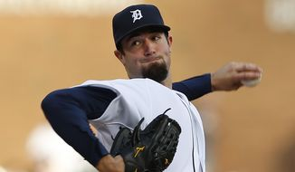Detroit Tigers pitcher Robbie Ray throws against the Houston Astros in the first inning of a baseball game in Detroit Tuesday, May 6, 2014. (AP Photo/Paul Sancya)