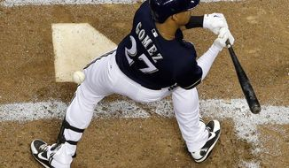 Milwaukee Brewers' Carlos Gomez is hit by a Pittsburgh Pirates' Gerrit Cole pitch during the third inning of a baseball game Tuesday, May 13, 2014, in Milwaukee. (AP Photo/Morry Gash)
