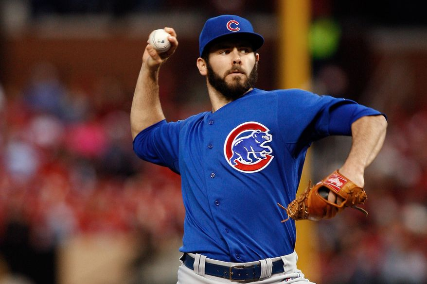 Chicago Cubs starting pitcher Jake Arrieta throws during the first inning of a baseball game against the St. Louis Cardinals on Tuesday, May 13, 2014, in St. Louis. (AP Photo/Scott Kane)