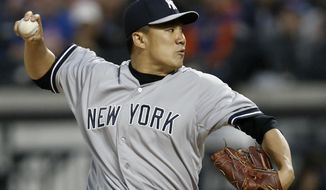 New York Yankees starting pitcher Masahiro Tanaka (19) delivers in the first inning against the New York Mets in a baseball game in New York, Wednesday, May 14, 2014. (AP Photo/)