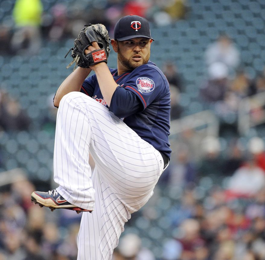 Minnesota Twins  starting pitcher Ricky Nolasco throws against the Boston Red Sox during the first inning of a baseball game in Minneapolis, Tuesday, May, 13, 2014. (AP Photo/Craig Lassig)