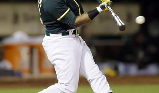 Oakland Athletics' Yoenis Cespedes connects for an RBI double off Chicago White Sox pitcher Scott Carroll in the fifth inning of a baseball game Tuesday, May 13, 2014, in Oakland, Calif. (AP Photo)