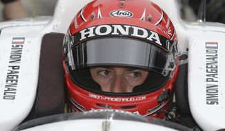 Simon Pagenaud, of France, sits in his car as he waits to practice for the Indianapolis 500 IndyCar auto race at Indianapolis Motor Speedway in Indianapolis, Wednesday, May 14, 2014. (AP Photo/Darron Cummings)