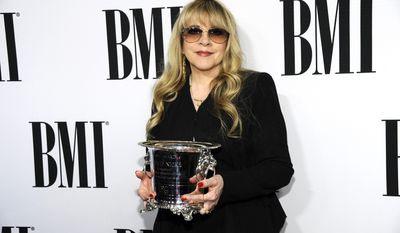 Stevie Nicks poses with the BMI Icon Award at the 62nd Annual BMI Pop Awards at the Beverly Wilshire Hotel on Tuesday, May 13, 2014, in Beverly Hills, Calif. (Photo by Chris Pizzello/Invision/AP)