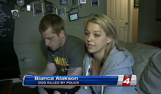Bianca Alakson and Ryan Showalter are devastated after they say police shot and killed their 10-month-old puppy while they were chasing a suspect through their fenced-in backyard in Redford Township. (WDIV-TV)