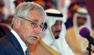 """U.S. Defense Secretary Chuck Hagel, addresses his Gulf counterparts in the Conference Palace, Jeddah, Saudi Arabia, Wednesday, May 14, 2014.  In remarks opening a conference, Hagel said Wednesday that Washington is hopeful of progress this week in the Iran deal-drafting talks in Vienna. Hagel said that regardless of the outcome of the Iran negotiations, the U.S. will remain """"postured and prepared"""" to ensure that Iran does not acquire a nuclear weapon. (AP Photo/Mandel Ngan, Pool)"""