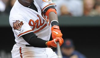 Baltimore Orioles' Adam Jones connects for a RBI single against the Detroit Tigers in the fifth inning of a baseball game Wednesday, May 14, 2014, in Baltimore. The Tigers won 7-5.(AP Photo/Gail Burton)