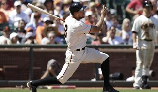 San Francisco Giants' Hunter Pence doubles to score Gregor Blanco during the fifth inning of a baseball game against the Atlanta Braves in San Francisco, Wednesday, May 14, 2014. (AP Photo)