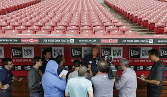 San Diego Padres manager Bud Black speaks to the media prior to the start of a baseball game against the Cincinnati Reds, Wednesday, May 14, 2014, in Cincinnati. The start of the game is being delayed by rain. (AP Photo)