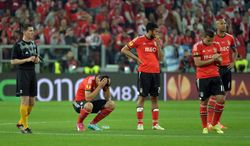 Benfica players react at the end of the Europa League soccer final between Sevilla and Benfica, at the Turin Juventus stadium in Turin, Italy, Wednesday, May 14, 2014.  Sevilla beat Benfica 4-2 on penalties to win the Europa League final. (AP Photo/Massimo Pinca)