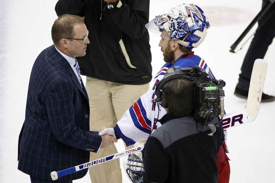 New York Rangers goalie Henrik Lundqvist shakes hands with Pittsburgh Penguins coach Dan Bylsma after the Rangers' 2-1 win in Game 7 of a second-round NHL playoff hockey series in Pittsburgh on Tuesday, May 13, 2014. (AP Photo)