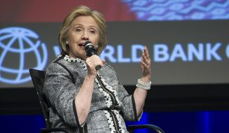 "Former Secretary of State Hillary Rodham Clinton participates in the World Bank Group's report ""Voice and Agency: Empowering Women and Girls for Shared Prosperity"" at World Bank headquarters in Washington, Wednesday, May 14, 2014. The report focuses on pervasive constraints facing women and girls worldwide. (AP Photo/Cliff Owen)"