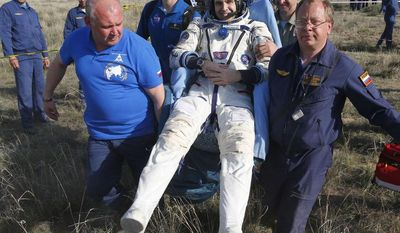 ** FILE ** Russian space agency rescue crew members carry U.S. astronaut Rick Mastracchio shortly after the Russian Soyuz TMA-11M space capsule landed, some 150 kilometers (93 miles) southeast of town Dzhezkazgan, Kazakhstan, Wednesday, May 14, 2014. The Soyuz space capsule with Mastracchio, Japanese astronaut Koichi Wakata and Russian cosmonaut Mikhail Tyurin, returning from a half-year mission to the International Space Station, landed safely Wednesday in Kazakhstan. (AP Photo/Dmitry Lovetsky, Pool)