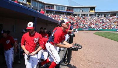 Bryce Harper and Ryan Zimmerman of the Washington Nationals take the field during their Grapefruit League game against the Detroit Tigers during Spring Training at Space Coast Stadium in Viera, Florida on March 20, 2014.    Photo by Gregg Newton