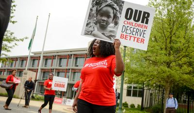 Act4Accountability Lead Organizer Omolola Adele-Oso march with about a dozen members of Act4Accountability outside of the Nigerian Embassy to call on the government to act to return hundreds of kidnapped Nigerian schoolgirls, Washington, D.C., Wednesday, May 14, 2014. (Andrew Harnik/The Washington Times)
