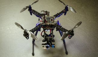 """** FILE ** This photo provided by Christopher Vo shows a drone that will be operating at Saturday's Smithsonian magazines """"The Future is Here"""" festival in Washington. (AP Photo/Christopher Vo)"""