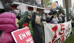 Protesters picket outside of a Burger King restaurant on East Washington Avenue in Madison, Wis., Thursday, May 15, 2014. Protesters in Madison joined others across the world gathering to turn up the pressure on fast-food chains to raise worker pay. (AP Photo/Wisconsin State Journal, M.P. King)